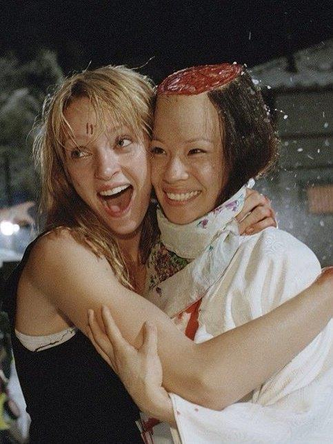 Uma Thurman and Lucy Liu on the set of *Kill Bill Volume 1* (2003).