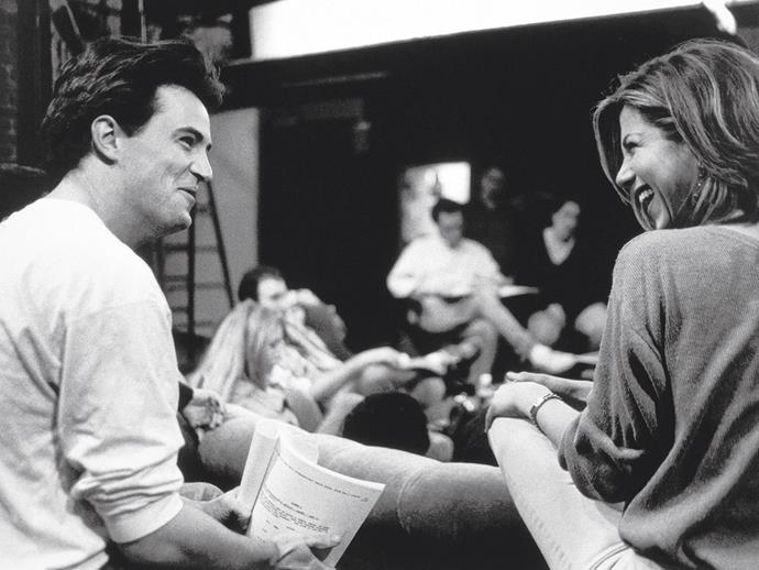 Matthew Perry and Jennifer Aniston on the set of *Friends*.