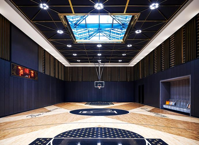 "Graham's personal NBA-sized basketball court, featuring decals by his lifestyle brand, October's Very Own. <br><br> *Image by Jason Schmidt for [Architectural Digest.](https://www.architecturaldigest.com/story/inside-rapper-drakes-hometown-manor-in-toronto|target=""_blank""