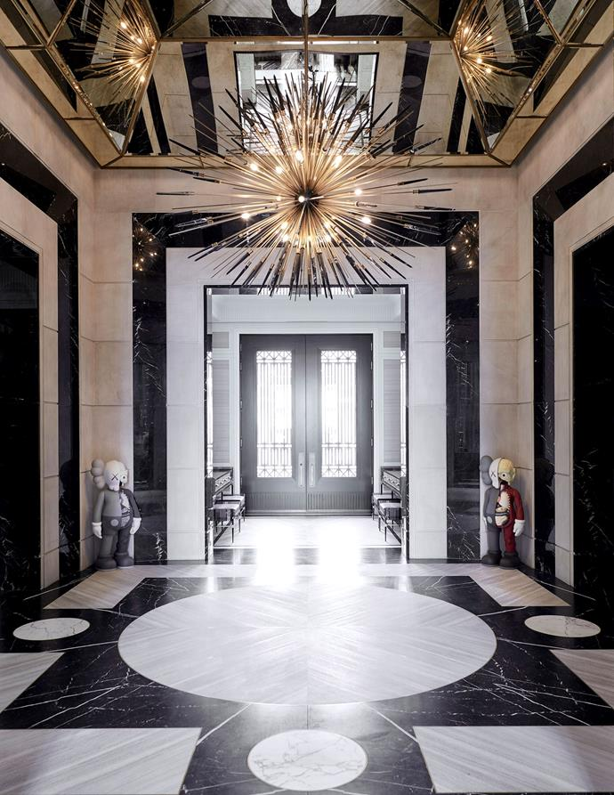 "The entryway to the home, fitted with the same custom chandeliers from the staircase. <br><br> *Image by Jason Schmidt for [Architectural Digest.](https://www.architecturaldigest.com/story/inside-rapper-drakes-hometown-manor-in-toronto|target=""_blank""
