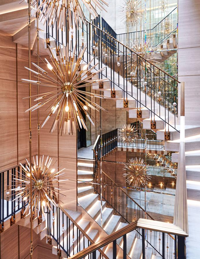 "The block marble staircase, featuring custom-made chandeliers. <br><br> *Image by Jason Schmidt for [Architectural Digest.](https://www.architecturaldigest.com/story/inside-rapper-drakes-hometown-manor-in-toronto|target=""_blank""