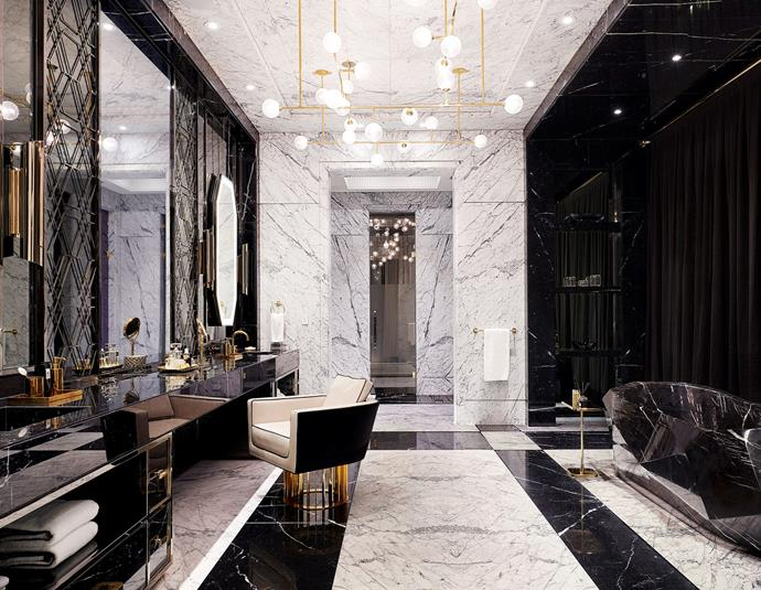 "The master bathroom, featuring a matching marble vanity and tub. <br><br> *Image by Jason Schmidt for [Architectural Digest.](https://www.architecturaldigest.com/story/inside-rapper-drakes-hometown-manor-in-toronto|target=""_blank""