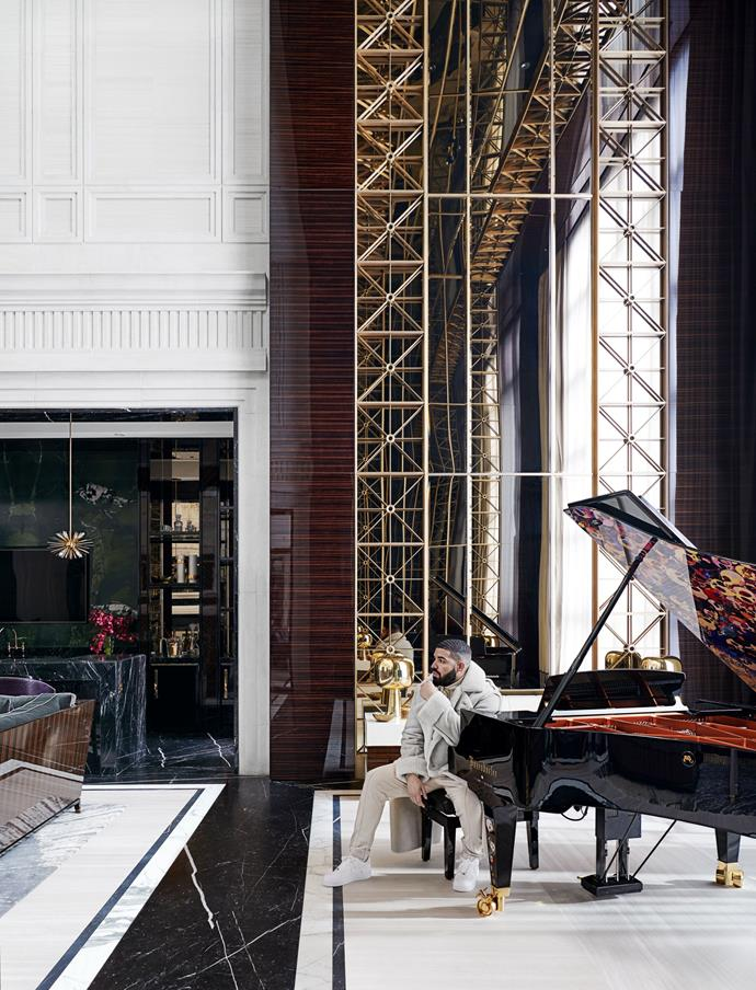 "Drake sitting by his grand piano in the living room, which seemingly endless ceilings. <br><br> *Image by Jason Schmidt for [Architectural Digest.](https://www.architecturaldigest.com/story/inside-rapper-drakes-hometown-manor-in-toronto|target=""_blank""