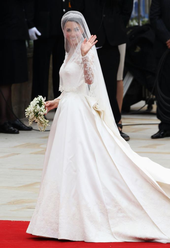 "**Kate Middleton, the Duchess of Cambridge in Alexander McQueen (2011)** <br><br> Seven years before Meghan walked down the aisle, her sister-in-law, Kate Middleton, wed Prince William in a bespoke Sarah Burton for Alexander McQueen gown that's easily one of the most famous dresses of all time. <br><br> As the future Queen of England, Kate's gown featured embroidery of roses, daffodils, thistles and shamrocks, the national flowers of England, Wales, Scotland and Northern Ireland, respectively. Per *[Good Housekeeping](https://www.goodhousekeeping.com/beauty/fashion/g4690/kate-middleton-wedding-dress/|target=""_blank""