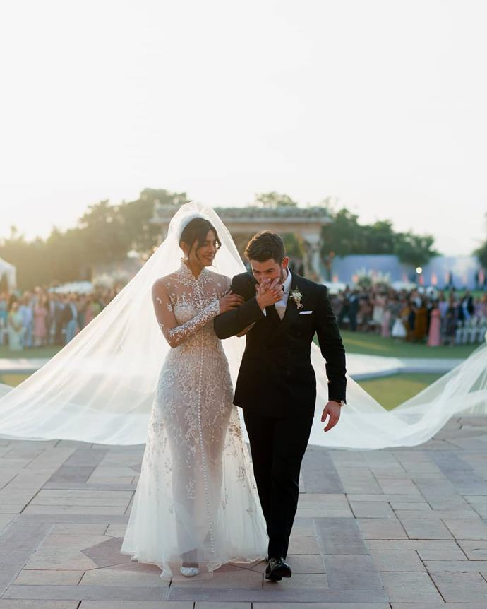 "**Priyanka Chopra in Ralph Lauren (2018)** <br><br> Chopra and Nick Jonas' Indian wedding extravaganza saw the actress walk down the aisle in a lacy custom Ralph Lauren dress, which featured a 22-metre train. The gown was later revealed to have included several different hidden messages, including a piece of Jonas' mother's wedding dress, the couple's wedding date, and the names of several of their family members embroidered in the lace. <br><br> *Image: Instagram [@priyankachopra](https://www.instagram.com/p/Bq9zP62ntiK/|target=""_blank""