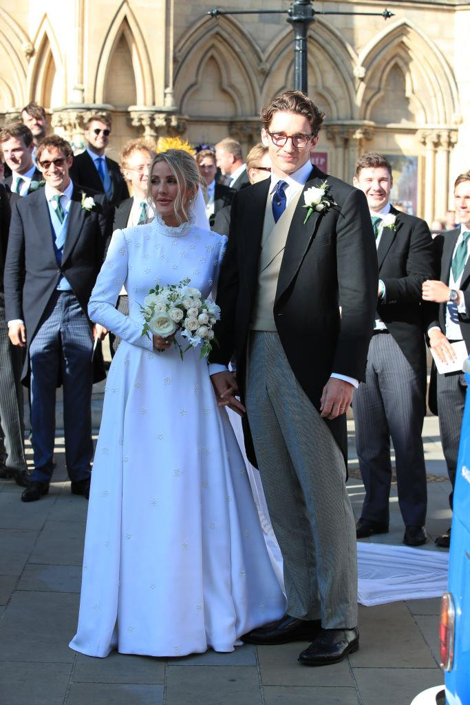 "**Ellie Goulding in custom Chloé (2019)** <br><br> For her marriage to art dealer Caspar Jopling, Ellie Goulding walked down the aisle in a very classic Chloé gown, which definitely fit the conservative brief for their star-studded English church [wedding](https://www.harpersbazaar.com.au/bazaar-bride/ellie-goulding-wedding-guests-19205|target=""_blank"") at York Minster. The ""Love Me Like You Do"" singer later revealed that the letters 'E' and 'J' (herself and her husband's first name initials) were embroidered into her veil. <br><br> *Image: Getty*"