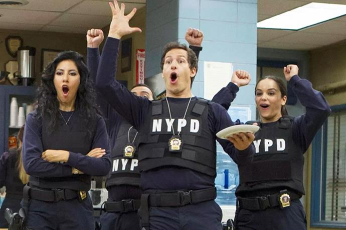 **8.** ***Brooklyn Nine-Nine***<br><br>  We know, we know, *Brooklyn Nine-Nine* is not that old and very much still an ongoing series. *However*, it did start in 2013, which feels like a lifetime ago, and frankly, it's an era we very much wouldn't mind going back to right now. Now, vibe-wise, this show offers comfort in spades! Between the cast's ludicrously good chemistry and comic timing, the kooky yet pleasantly repetitive storylines (Jimmy Jab Games and Pontiac Bandit, anyone?) and the extremely quotable nature of the series, there's just so much love about it and that's why it's coming in at eighth place. Don't @ us.