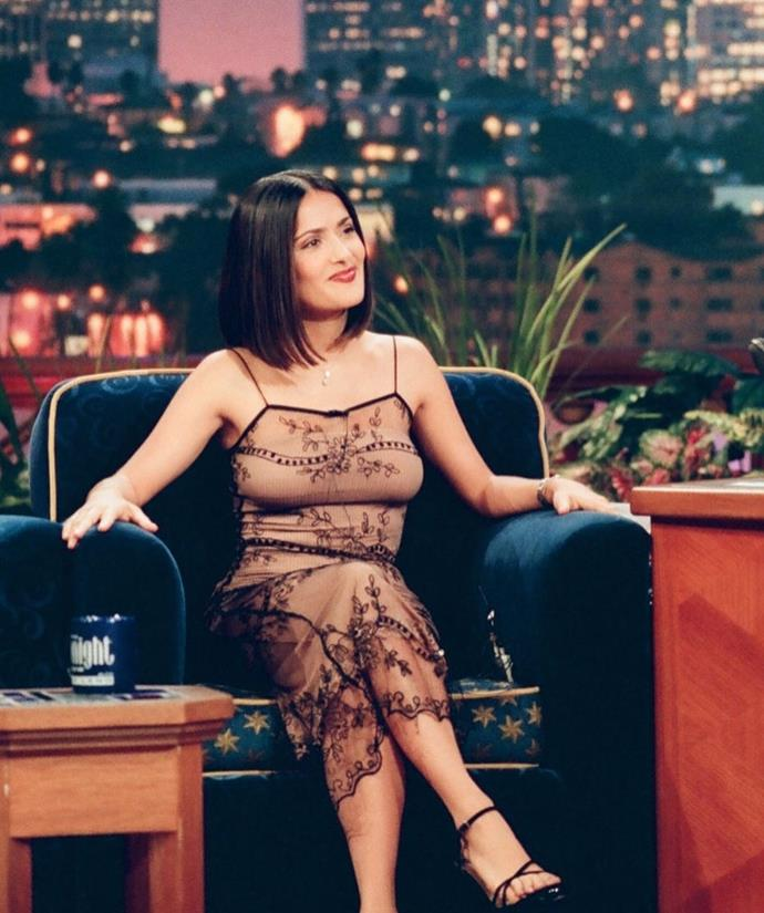 "Salma Hayek in a lace printed dress on *The Tonight Show with Jay Leno* in April 1999. <br><br> *Image: Instagram [@virgomood](https://www.instagram.com/p/B_SXtS5D-sM/|target=""_blank""
