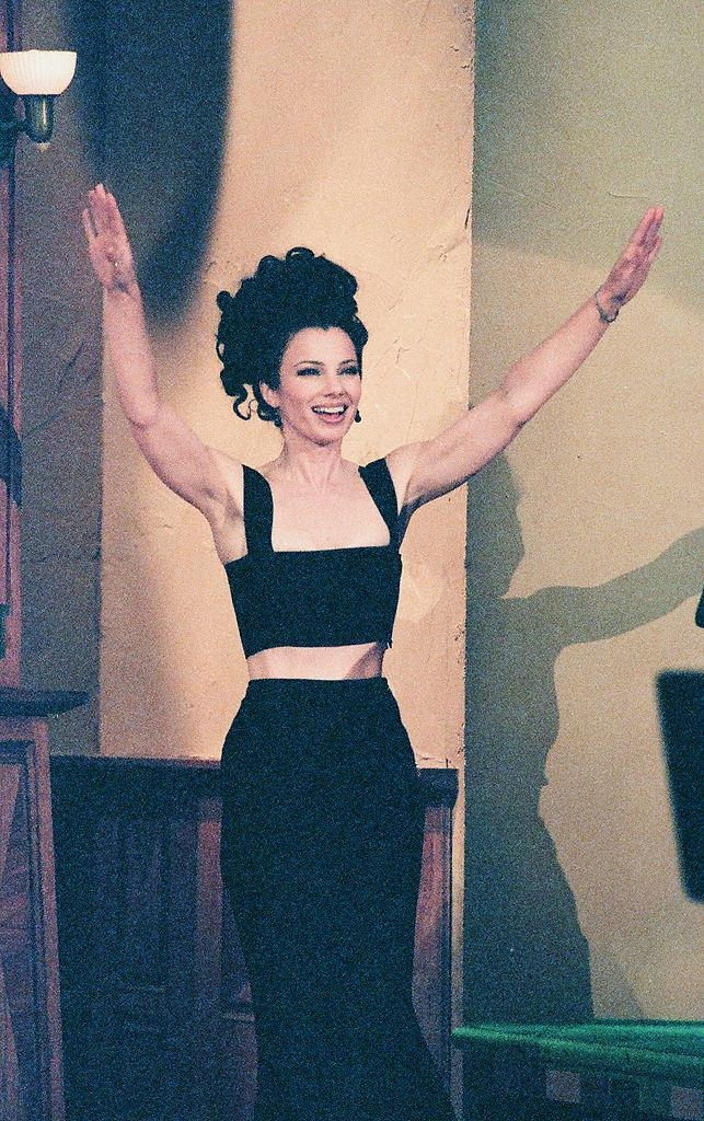 Fran Drescher in a black crop-top and skirt on *The Tonight Show with Jay Leno* in March 1996.