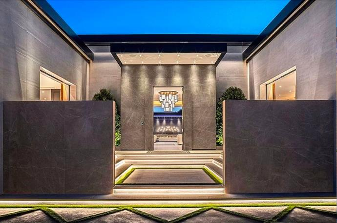 "The entryway to the home is almost as magnificent as the rest of the compound. <br><br> *Image by [MLS/Zillow](https://www.zillow.com/homedetails/145-N-Mapleton-Dr-Los-Angeles-CA-90077/20523926_zpid/?|target=""_blank""
