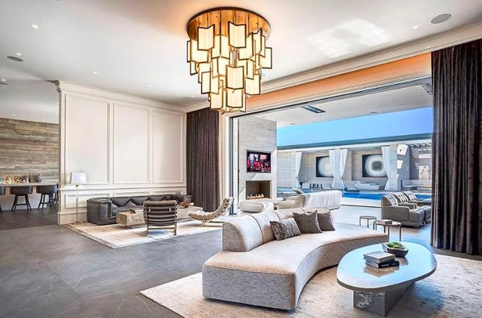 "The living room overlooks the rest of the open-plan residence. <br><br> *Image by [MLS/Zillow](https://www.zillow.com/homedetails/145-N-Mapleton-Dr-Los-Angeles-CA-90077/20523926_zpid/?|target=""_blank""