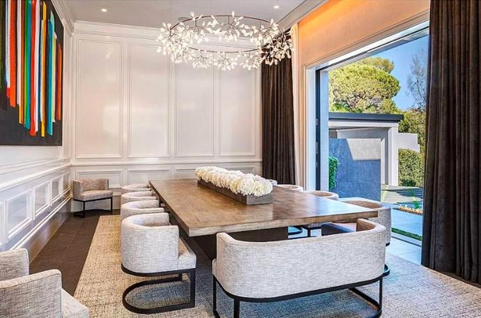 "The dining room adorned with flowers. <br><br> *Image by [MLS/Zillow](https://www.zillow.com/homedetails/145-N-Mapleton-Dr-Los-Angeles-CA-90077/20523926_zpid/?|target=""_blank""