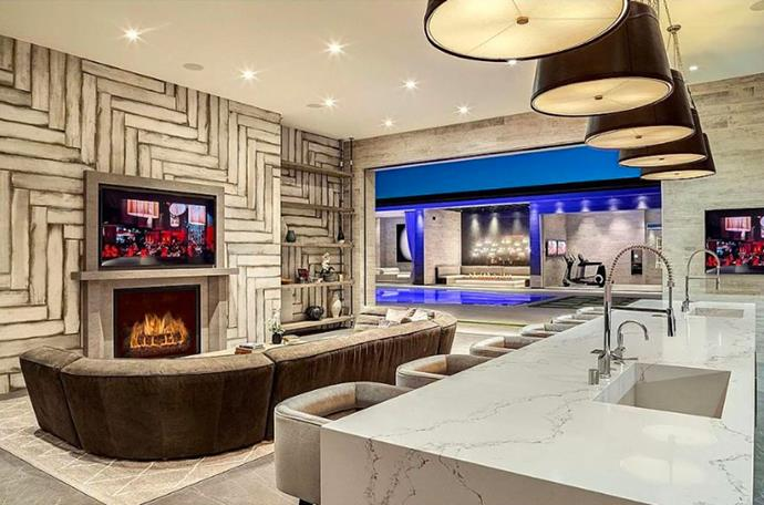 "One of the many living rooms, fit with a luxurious kitchenette. <br><br> *Image by [MLS/Zillow](https://www.zillow.com/homedetails/145-N-Mapleton-Dr-Los-Angeles-CA-90077/20523926_zpid/?|target=""_blank""