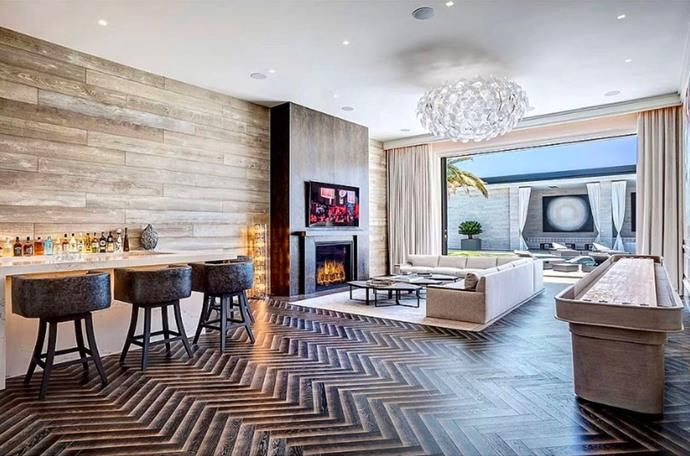 "One of many bars and lounging areas. Each room seems to follow a warm, neutral colour palette. <br><br> *Image by [MLS/Zillow](https://www.zillow.com/homedetails/145-N-Mapleton-Dr-Los-Angeles-CA-90077/20523926_zpid/?|target=""_blank""