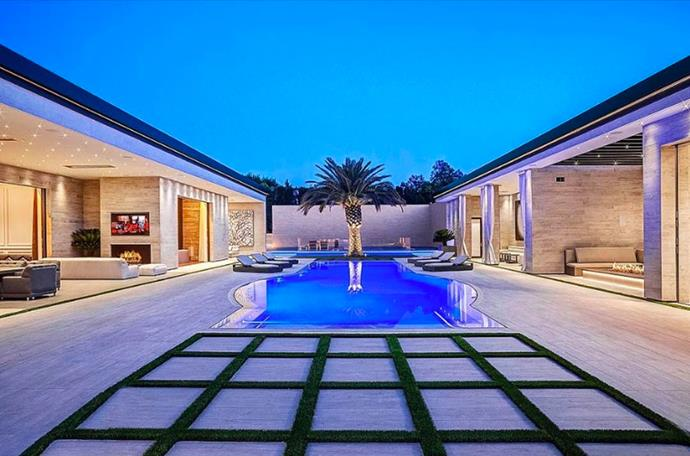 "The courtyard, featuring a pool and signature palm tree, appears to be the centre point of the property. <br><br> *Image by [MLS/Zillow](https://www.zillow.com/homedetails/145-N-Mapleton-Dr-Los-Angeles-CA-90077/20523926_zpid/?|target=""_blank""