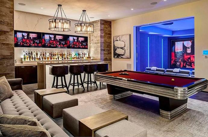 "One of the multiple games rooms located in the compound. <br><br> *Image by [MLS/Zillow](https://www.zillow.com/homedetails/145-N-Mapleton-Dr-Los-Angeles-CA-90077/20523926_zpid/?|target=""_blank""