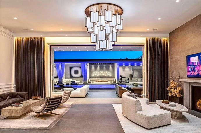 "Each room seems to face one another, with the anatomy of the lavish pad giving the effect of a beach club resort. <br><br> *Image by [MLS/Zillow](https://www.zillow.com/homedetails/145-N-Mapleton-Dr-Los-Angeles-CA-90077/20523926_zpid/?|target=""_blank""