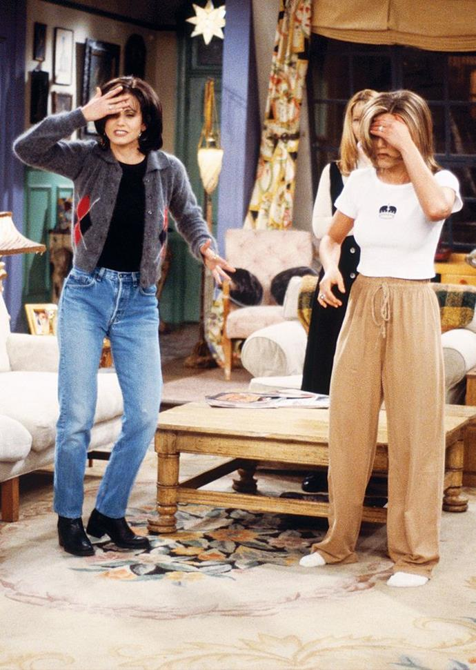 """**Monica Geller and Rachel Green in *Friends*** <br><br> *The '90s Loungewear Look* <br><br> Living in the age of loungewear ensembles, Rachel's camel-coloured track suit bottoms and cropped printed tee is the ultimate way to stay comfortable without compromising on style. And since we know that [Monica's style](https://www.elle.com.au/culture/monica-geller-friends-outfits-19757