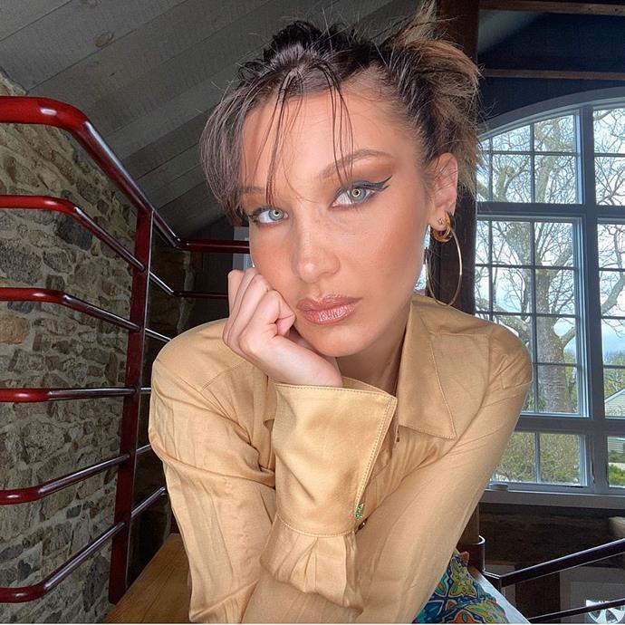 "May 2020 (with a quarantine [fringe she cut herself](https://www.elle.com.au/beauty/bella-hadid-fringe-23354|target=""_blank""))<br><br>  *Image via [@bellahadid](https://www.instagram.com/p/B_ppil1gD9j/|target=""_blank""|rel=""nofollow"")*"