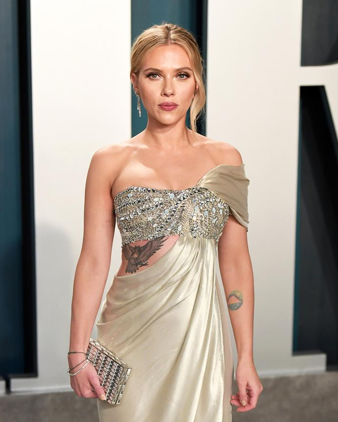 Rarely seen, Johansson also has this sizeable bird on her rib cage. If it weren't for her red carpet moments, we'd never know about her love of ink.