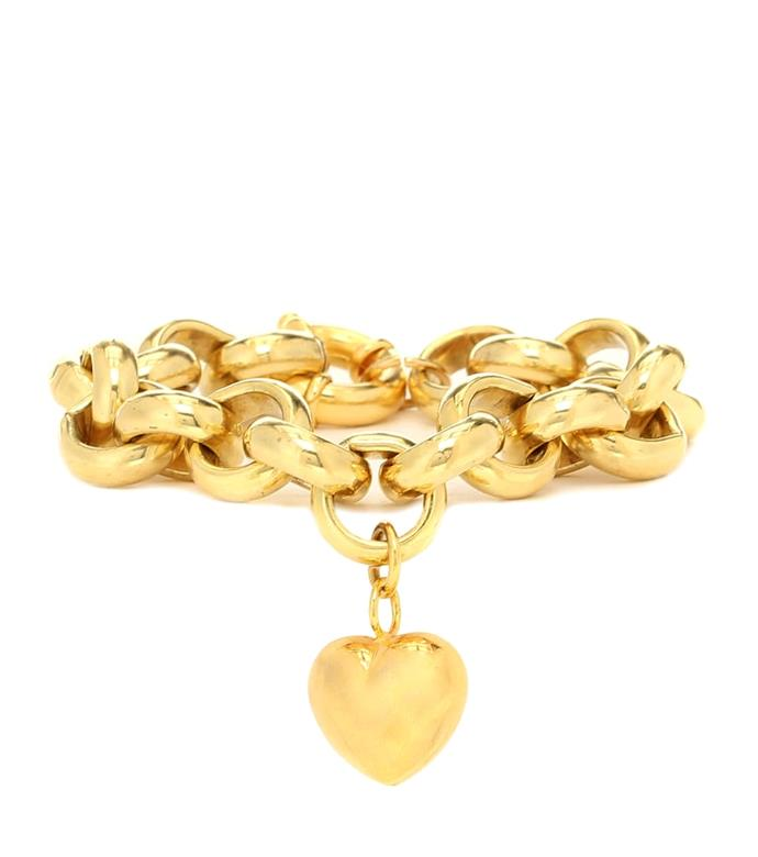"'Gold-Plated Bracelet With Heart Charm', $545 at [MYTHERESA](https://www.mytheresa.com/en-au/timeless-pearly-exclusive-to-mytheresa-gold-plated-bracelet-with-heart-charm-1346001.html?gclid=CjwKCAjwwYP2BRBGEiwAkoBpArgmZ9mp24iq5bIFSUJ0iJcTVLbb1hDAyVSomwViEMhjOLdiOgn-ZxoCC5oQAvD_BwE&utm_source=sea_pla&utm_medium=google&utm_campaign=google_sea&ef_id=CjwKCAjwwYP2BRBGEiwAkoBpArgmZ9mp24iq5bIFSUJ0iJcTVLbb1hDAyVSomwViEMhjOLdiOgn-ZxoCC5oQAvD_BwE:G:s?pr=|target=""_blank""