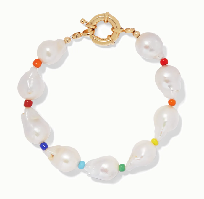 "'Asti Pearl And Bead Anklet' by Éliou, $270.46 at [NET-A-PORTER](https://www.net-a-porter.com/en-au/shop/product/eliou/asti-pearl-and-bead-anklet/1147749|target=""_blank""