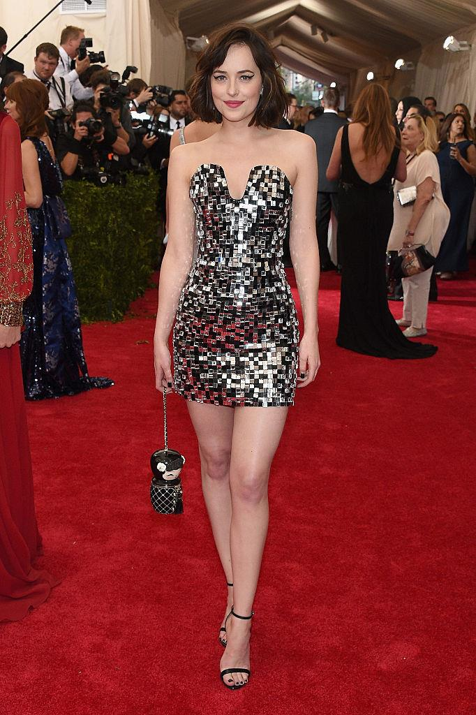 **Dakota Johnson in Chanel (2015)** <br><br> Shortly before Johnson became an ambassador for Gucci, she wowed in this metallic (albeit definitely cocktail-friendly) Chanel number at the 2015 ball.