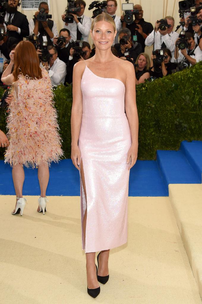 """**Gwyneth Paltrow in Calvin Klein (2017)** <br><br> Four years after slamming the Met Gala for being """"un-fun,"""" """"boiling"""" and """"too crowded"""", Paltrow attended the 2017 gala in this sleek, short Calvin Klein dress, which definitely wouldn't allow for overheating."""