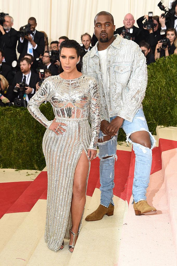 **Kanye West in Balmain (2016)** <br><br> West has made a name for himself by not following the rules, and that mantra definitely extends to his fashion choices. The rapper sported ripped denim jeans and a t-shirt to the 2016 ball, but his look definitely still involved couture elements, not limited to his intricately-embroidered denim jacket.