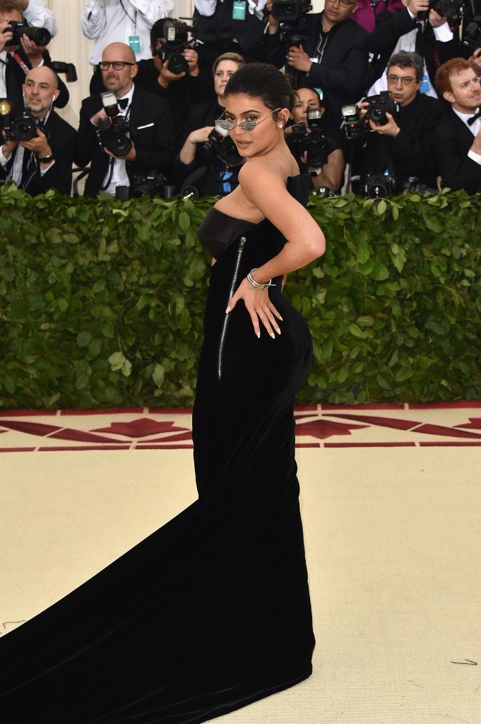**Kylie Jenner in Alexander Wang (2018)** <br><br> Jenner's monochromatic Alexander Wang look was notably devoid of any on-theme elements, and we can easily say she's one of the first Met Gala guests to ever wear sunglasses (even if they were decorative, crystal-adorned ones).