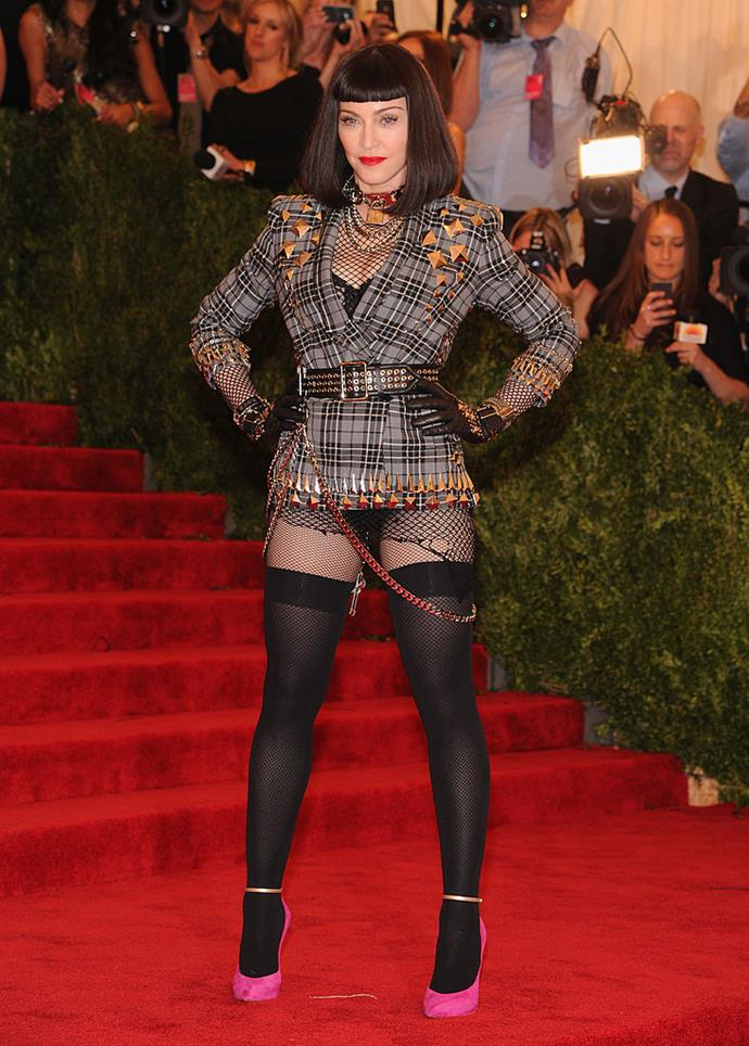 """**Madonna in Givenchy (2013)** <br><br> Since the theme of the 2013 Met was 'Punk: Chaos to Couture', it could be argued that Madonna wasn't """"too casual"""" at all. However, her mini blazer dress and stockings (courtesy of Givenchy's then-creative director, Riccardo Tisci) definitely stood out from other guests."""