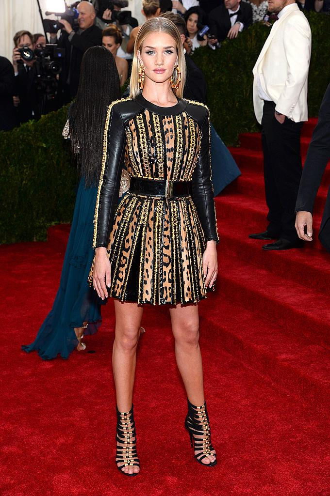 **Rosie Huntington-Whiteley in Balmain (2014)** <br><br> Call it too simple or not 'ball-friendly' enough, but when Rosie Huntington-Whiteley wore this intricate leopard-and-leather Balmain party dress (one of the most recognisable pieces by creative director Olivier Rousteing), it was one of the year's most-photographed looks.