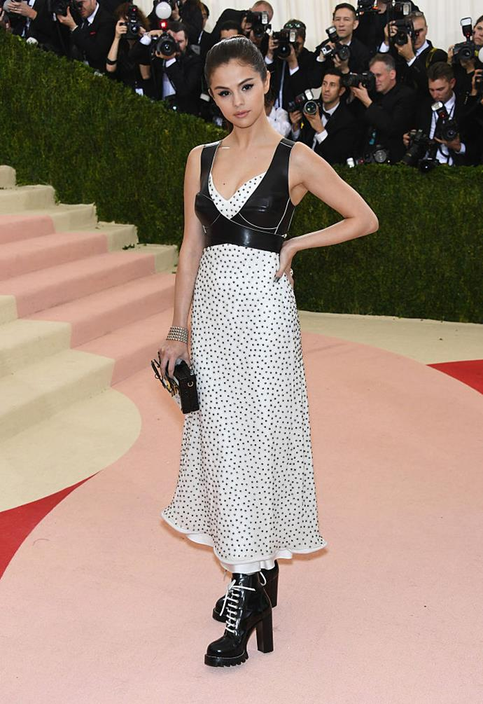 **Selena Gomez in Louis Vuitton (2016)** <br><br> As she was a Louis Vuitton muse at the time, Gomez wore this conceptual, informal number to the 2016 Met, featuring an external leather bra and the brand's popular chunky heeled boots.