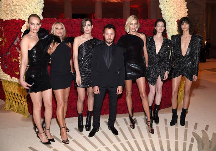 **Amber Valletta, Kate Moss, Charlotte Casiraghi, Anthony Vaccarello, Anja Rubik, Charlotte Gainsbourg and Mica Argañaraz in Saint Laurent (2018)** <br><br> Though the theme of the 2018 Met Ball was 'Fashion and the Catholic Imagination', Saint Laurent creative director Anthony Vaccarello instead chose to dress his friends and muses in similar, slinky black party dresses.
