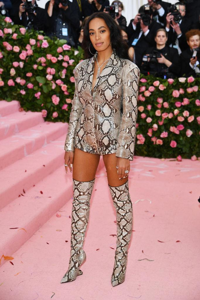 **Solange in Salvatore Ferragamo (2019)** <br><br> Before the 2019 gala, Solange posed with a literal snake that camouflaged with her Ferragamo look. As it wouldn't be very ethical to subject an animal to camera flashes, the performer ditched the snake before she hit the red carpet in this camp-but-comfortable outfit.