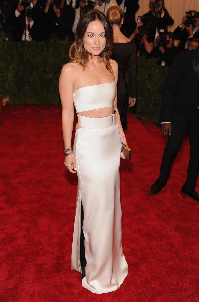 **Olivia Wilde in Calvin Klein (2013)** <br><br> By all intents and purposes, Olivia Wilde didn't quite nail the theme of 2013's 'Punk: Chaos to Couture' ball, but that doesn't mean we can't marvel at the fit of her Calvin Klein two-piece dress.