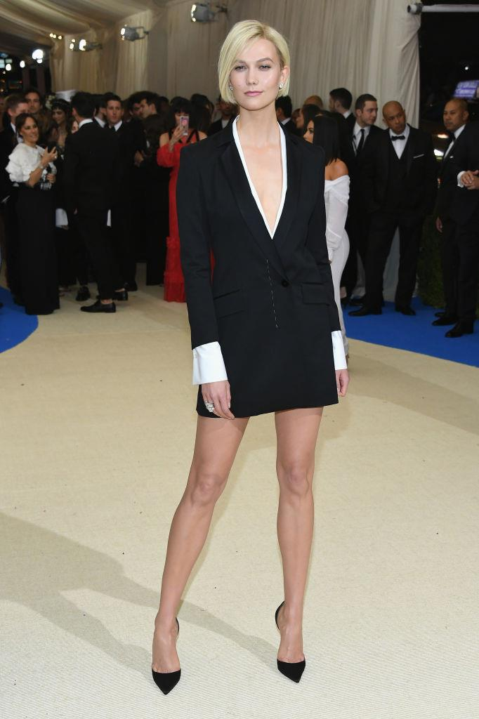 """**Karlie Kloss in Carolina Herrera (2017)** <br><br> Kloss has been known to favour more understated Met Gala looks in the past, and her 2017 outfit (courtesy of Carolina Herrera) toed the line between cocktail and corporate-chic. In a 2020 video on her [YouTube channel](https://www.youtube.com/watch?v=rOXYHo-mge8