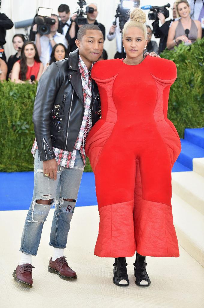 **Pharrell in Comme des Garçons (2017)** <br><br> As much as we love Pharrell's outfit (Comme des Garçons, paired with Dr. Martens brogues), he definitely let his wife, Helen Lasichanh's experimental Comme des Garçons outfit do all the talking when they appeared at the 2017 ball.