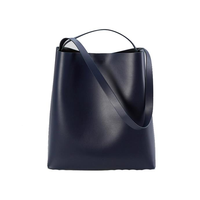 """**A carryall**<br><br> Bag by Aesther Ekme, $840 at [My Chameleon](https://www.mychameleon.com.au/fashion/bags/carry-all/sac-leather-tote-eclipse-aesther-ekme