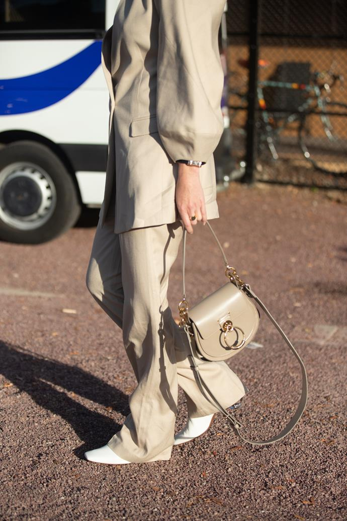 **A goes-with-everything designer handbag**<br><br> There's always something to be said about the bag of the moment, whether it's tiny top-handles or logo-printed crossbodies, but if you're going to invest in something, make it a classic. You know, the take-anywhere, wear-with-anything bag with a $0 cost-per-wear? Every girl needs one.
