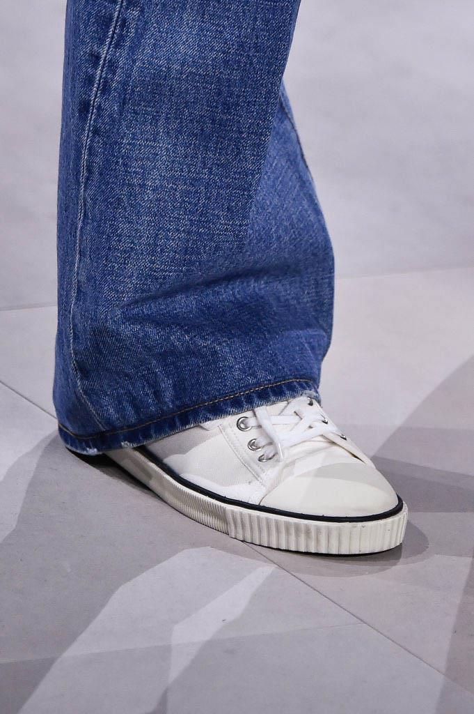 """**The return of the tennis shoe** <br><br> As much as Converse are an eternally-faithful addition to our shoe closets, the timeless flat 'tennis shoe' is as chic as it gets. However, the icing on the cake for us was seeing vintage-style sneakers paired with denim on the runway at [Celine](https://www.harpersbazaar.com.au/fashion/celine-hedi-slimane-17453 target=""""_blank"""")—proving that simple, understated sneaker styles are more in favour than the exaggerated '[dad sneakers](https://www.elle.com.au/fashion/grandpa-sneakers-20992 target=""""_blank"""")' of seasons' past. <br><br> *Pictured: Celine spring/summer '20*"""