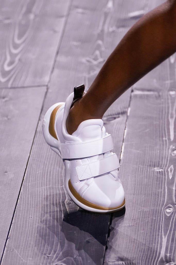 """**Futuristic silhouettes** <br><br> For every pared-back, low-key sneaker style shown on the runway at [autumn/winter '20](https://www.harpersbazaar.com.au/fashion/paris-fashion-week-autumn-2020-runway-19997 target=""""_blank""""), there was another pair that provided an interpretation of sneakers of the future. Even if you'd usually veer towards something a little more timeless, there's no shame in a pair of trainers that'll make you stand out in the crowd (plus, you'd be surprised just how timeless some of them actually are). <br><br> *Pictured: Louis Vuitton autumn/winter '20*"""
