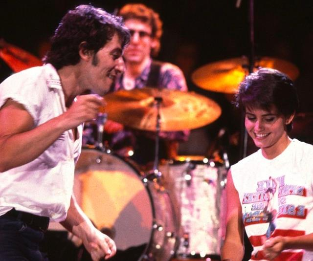 "**Courteney Cox in Bruce Springsteen's video for ""Dancing In The Dark""** <br><br> Courteney Cox's famous cameo in Bruce Springsteen's ""Dancing In The Dark"" is possibly the most legendary celebrity appearance to date. Filmed 10 years before *Friends*, the video is set at a Springsteen concert where he makes eye contact with a pixie-cut Cox in the front row, and brings her on stage to dance. Basically living every concertgoer's dream, Cox's dance moment has become the most memorable takeaway from the entire video. <br><br> *Watch it [here](https://www.youtube.com/watch?v=129kuDCQtHs