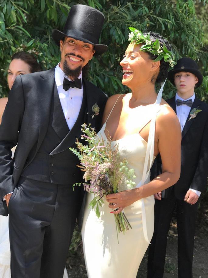**Tracee Ellis Ross** <br><br> Tracee Ellis Ross served as a bridesmaid in her brother Ross Arne Naess's wedding, including sister-in-law Ashlee Simpson. Ross wore a simple white slip dress and wreath crown.