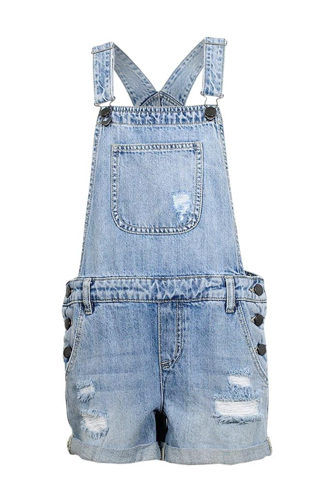 **Denim Overalls** <br><br> Matched with a skateboard and a cap worn backwards, the denim overall was a staple for any 'cool kid' of the '90s. And if you were super cool, you'd leave only one strap just hanging open, for a carefree look.