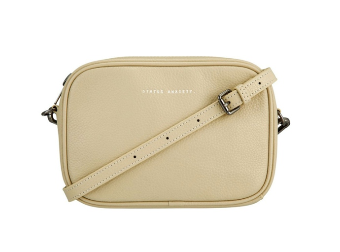 """Plunder Zip Top Crossbody Bag in Natural, $169.95 by Status Anxiety at [Myer](https://www.myer.com.au/p/status-anxiety-sa7257-plunder-zip-top-crossbody-593646850-1