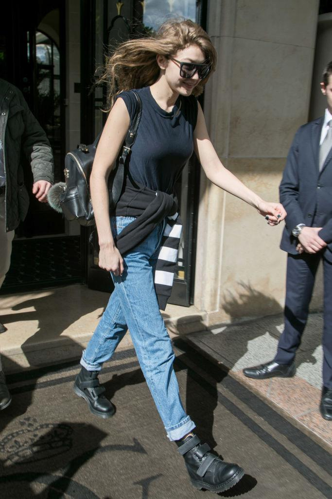 Gigi Hadid nails casual chic with a backpack slung over one shoulder and a jeans-and-t-shirt combo.