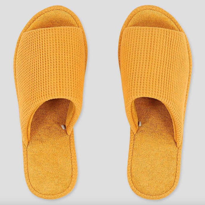"Waffle Room Slippers in Yellow, $19.90 by [Uniqlo](https://www.uniqlo.com/au/store/waffle-room-shoes-4234970001.html?#more_views|target=""_blank""