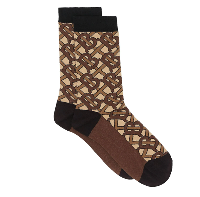 "Monogram Intarsia Cotton Blend Socks, $140 by Burberry at [Farfetch](https://www.farfetch.com/au/shopping/women/burberry-monogram-intarsia-cotton-blend-socks-item-14075876.aspx?storeid=9462|target=""_blank""