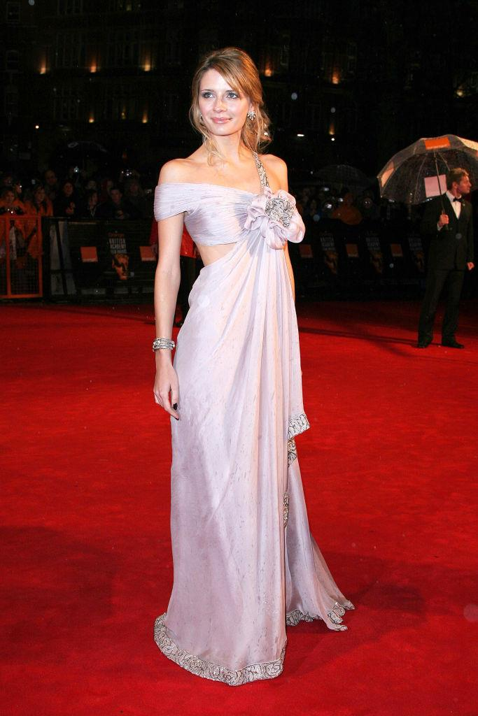 **Mischa Barton in Marchesa at the 2006 British Academy Film Awards**<br><br>  We can't help it, we have a soft spot for this look. The soft draping, the floral accent, the off-shoulder: just another magical Mischa Barton moment.
